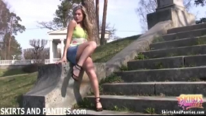 Young Ann flashing panties outdoors