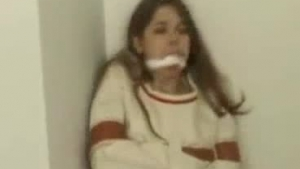 Brunette teen gets tied and gagged